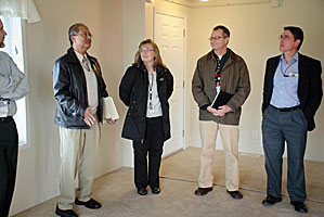 Photo of PNNL researcher Subrato Chandra (left) giving a tour of the homes