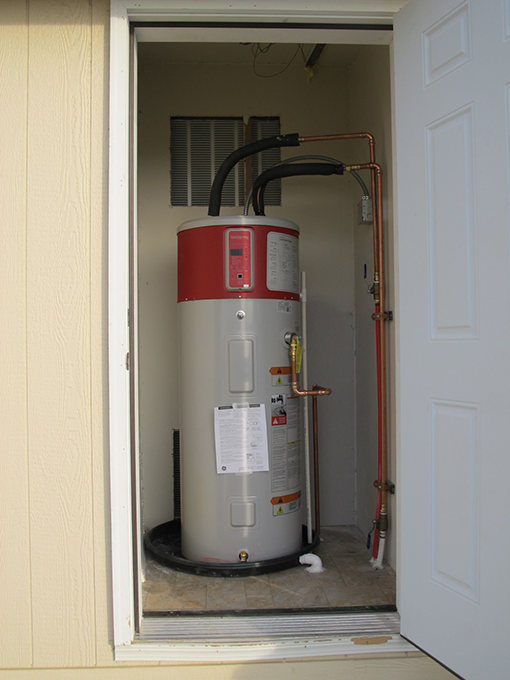 General Electric's heat pump water heater is installed in the Experimental Home's exterior closet.