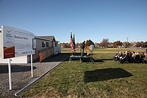 Photo of PNNL researcher Graham Parker addressing the audience in front of the Baseline Homes.